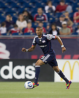 New England Revolution defender Darrius Barnes (25) dribbles at midfield. In a Major League Soccer (MLS) match, the New England Revolution tied Toronto FC, 0-0, at Gillette Stadium on June 15, 2011.