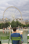 Man reading French newspaper in Jardin des Tuileries and the Louvre Museum, Paris, France. .  John offers private photo tours in Denver, Boulder and throughout Colorado, USA.  Year-round. .  John offers private photo tours in Denver, Boulder and throughout Colorado. Year-round.