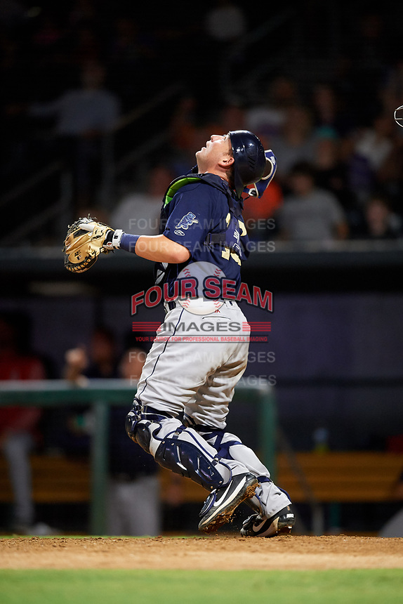 Mobile BayBears catcher Michael Barash (16) tracks down a pop up during a game against the Jacksonville Jumbo Shrimp on April 14, 2018 at Baseball Grounds of Jacksonville in Jacksonville, Florida.  Mobile defeated Jacksonville 13-3.  (Mike Janes/Four Seam Images)