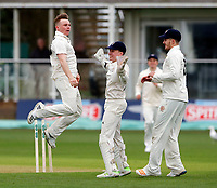 Oxford bowler Wilkinson (L) celebrates after bowling Sean Dickson during the friendly game between Kent CCC and Oxford University at the St Lawrence Ground, Canterbury, on Sun Apr 1, 2018