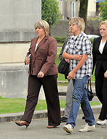 Pictured: The mother of Joshua Davies Hayley (L), with a young man believed to be his brother (R) arriving at Swansea Crown Court. Friday 02 September 2011<br /> Re: A 16-year-old boy who battered his former girlfriend to death is due to be sentenced on today (Fri 02 September 2011) for her murder.<br /> Rebecca Aylward, 15, from Maesteg, was lured into a wood in Aberkenfig, near Bridgend, in October 2010. <br /> Joshua Davies denied murder, blaming his friend, but was convicted by a 10-2 majority verdict in July.