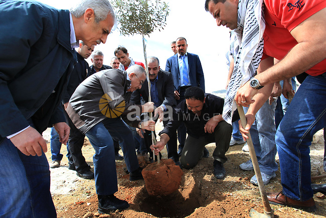 "Palestinian prime minister Salam Fayyad participates in a cultivation of olive trees on the occasion of ""Land Day"", in the village of Bab al-Shams, northwest of Jerusalem, on March 30, 2013. Land Day marks the annual event that commemorates the deaths of six Arab Israeli protesters at the hands of Israeli forces during mass demonstrations in 1976 against plans to confiscate Arab land in northern Israel. Photo by Mustafa Abu Dayeh"