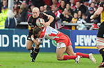 Richard Fussel is tackled by Olly Barkley. © Ian Cook IJC Photography iancook@ijcphotography.co.uk www.ijcphotography.co.uk