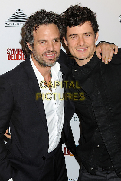 "MARK RUFFALO & ORLANDO BLOOM .""Sympathy for Delicious"" Release Party held at the Mondrian Hotel's SkyBar, .West Hollywood, California, .27th April 2011..half length suit  beard facial hair white shirt black jacket arm around .CAP/ADM/BP.©Byron Purvis/AdMedia/Capital Pictures."