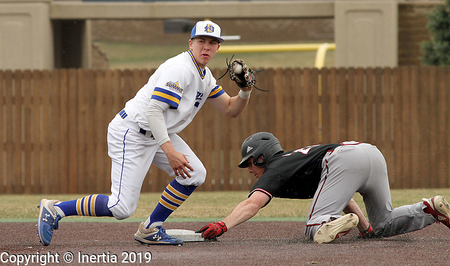 SIOUX FALLS, SD - APRIL 6: Gus Steiger from South Dakota State shows the ball to the umpire as Breyden Eckhout from Nebraska Omaha slides safely into second Saturday afternoon in Sioux Falls.  (Photo by Dave Eggen/Inertia)