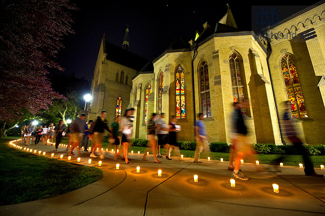 May 17, 2012; Seniors head to the Grotto by candlelight for their last visit before the 2012 Commencement. Photo by Barbara Johnston/University of Notre Dame