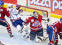 April 28, 2007; Hamilton, ON, CAN; Hamilton Bulldogs defenceman (2) Ryan O'Byrne (not pictured) scores on Rochester Americans goalie (30) Craig Anderson as Americans defenceman (5) Timo Helbling pushes Bulldogs centre (32) Ajay Baines into the net during the third period of game six of the AHL north division semifinal at Copps Coliseum. The Bulldogs won 6-2 and eliminated the Americans from the playoffs. Mandatory Credit: Ron Scheffler, Special to the Spectator. (File number RRSA8317).
