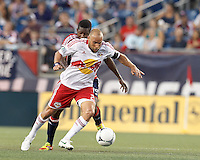 New York Red Bulls midfielder Joel Lindpere (20) dribbles as New England Revolution midfielder Clyde Simms (19) defends. In a Major League Soccer (MLS) match, New England Revolution defeated New York Red Bulls, 2-0, at Gillette Stadium on July 8, 2012.