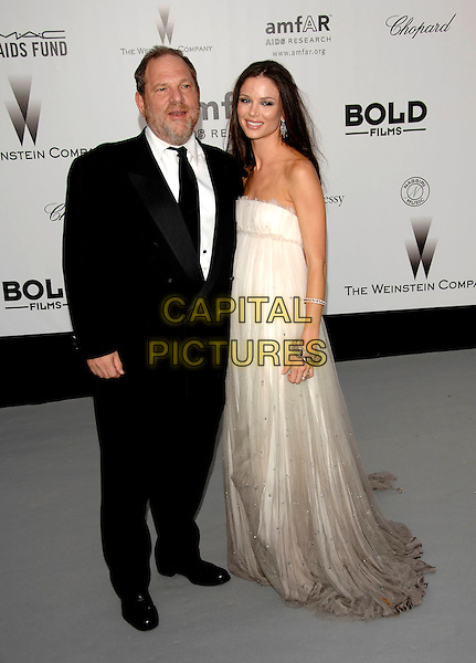 HARVEY WEINSTEIN & GEORGINA CHAPMAN .Arrivals to the Cinema Against AIDS 2007 in aid of amfAR at Le Moulin de Mougins during 60th International Cannes Film Festival, Cannes, France  .May 23rd, 2007.full length black suit white strapless dress couple gown grey gray .CAP/PL.©Phil Loftus/Capital Pictures