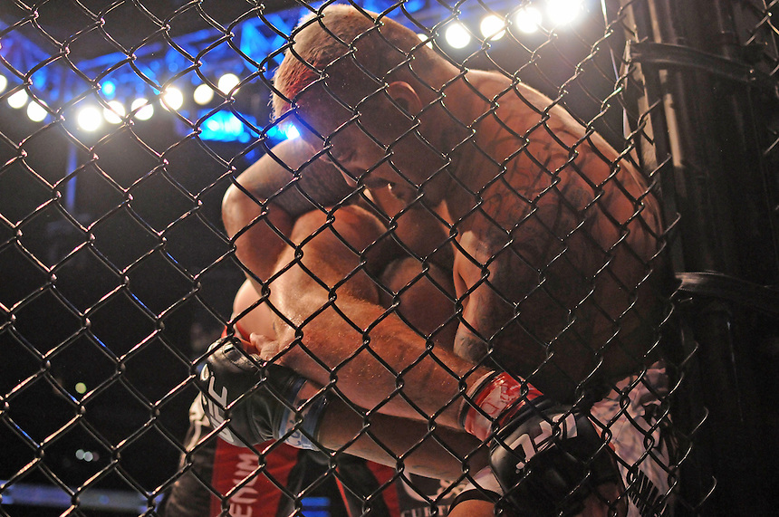 24 SEPTEMBER 2011:  Mark Hunt is pressed up against the wall of the octagon in his bout against Ben Rothwell   during UFC 135 at the Pepsi Center in Denver, Colorado. *****For Editorial Use Only*****