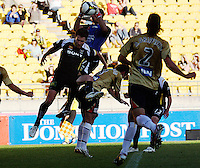 Newcastle keeper Ante Covic saves under pressure from Tim Brown during the A-League match between Wellington Phoenix and Newcastle Jets at Westpac Stadium, Wellington, New Zealand on Sunday, 4 January 2009. Photo: Dave Lintott / lintottphoto.co.nz