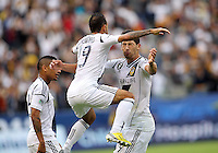 CARSON, CA - DECEMBER 01, 2012:   Omar Gonzalez (4) and  Juninho (19) of the Los Angeles Galaxy celebrate Gonzalez goal against the Houston Dynamo during the 2012 MLS Cup at the Home Depot Center, in Carson, California on December 01, 2012. The Galaxy won 3-1.