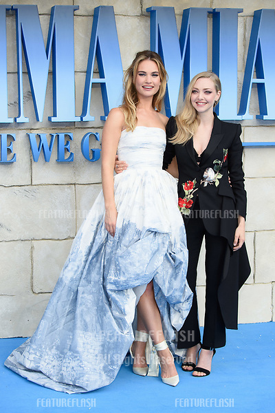 "Lily James & Amanda Seyfried arriving for the ""Mama Mia! Here We Go Again"" world premiere at the Eventim Apollo, Hammersmith, London, UK. <br /> 16 July  2018<br /> Picture: Steve Vas/Featureflash/SilverHub 0208 004 5359 sales@silverhubmedia.com"