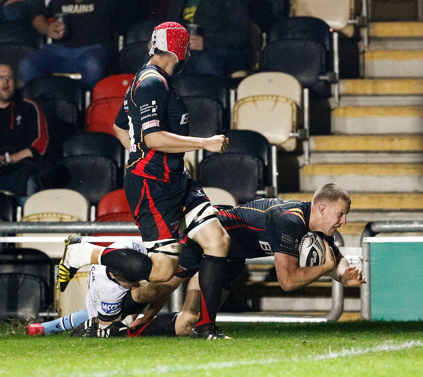 Jack Dixon of Newport Gwent Dragons scores his sides second try<br /> <br /> Photographer Simon King/CameraSport<br /> <br /> Guinness PRO12 Round 5 - Newport Gwent Dragons v Glasgow Warriors - Friday 30th September 2016 - Rodney Parade - Newport<br /> <br /> World Copyright &copy; 2016 CameraSport. All rights reserved. 43 Linden Ave. Countesthorpe. Leicester. England. LE8 5PG - Tel: +44 (0) 116 277 4147 - admin@camerasport.com - www.camerasport.com