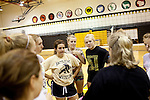 The junior varsity volleyball team huddles at Wright Senior High School in Wright, Wyoming August 2011. Wright's population teeters around 1,500. The town was settled in the 1970s with the start of the Black Thunder Coal Mine, one of the most productive in the United States.