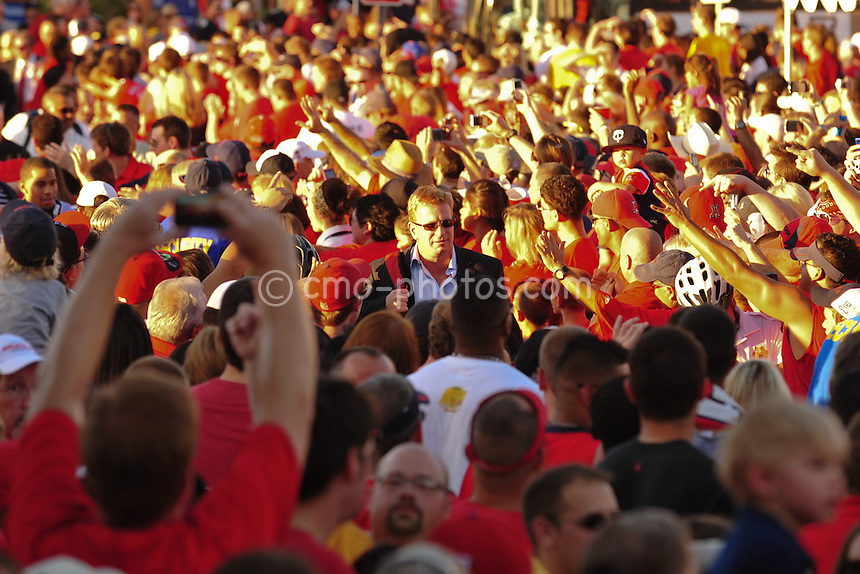 """Sept 18, 2010; Tucson, AZ, USA; Arizona Wildcats head coach Mike Stoops walks through a crowd of fans during """"Wildcat Walk"""" prior to a game against the Iowa Hawkeyes at Arizona Stadium."""