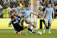 Ramiro Corrales (black) forward San Jose Earthquakeschallenges Davy Arnaud Sporting KC midfielder...Sporting KC defeated San Jose Earthquakes 1-0 at LIVESTRONG Sporting Park, Kansas City ,Kansas,..