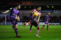 Port Vale's James Gibbons under pressure from Lincoln City's Bruno Andrade<br /> <br /> Photographer Chris Vaughan/CameraSport<br /> <br /> The EFL Sky Bet League Two - Lincoln City v Port Vale - Tuesday 1st January 2019 - Sincil Bank - Lincoln<br /> <br /> World Copyright &copy; 2019 CameraSport. All rights reserved. 43 Linden Ave. Countesthorpe. Leicester. England. LE8 5PG - Tel: +44 (0) 116 277 4147 - admin@camerasport.com - www.camerasport.com
