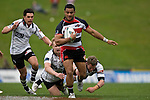 Lelia Masaga bursts between 2 Hawkes Bay tacklers.  Air New Zealand Cup Rugby game between Counties Manukau & Hawkes Bay, played at Growers Stadium Pukekohe on Sunday 14th of September 2008.