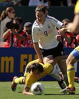 Birgit Prinz(Ger) v Jane Toernqvist(SWE).; Women's World Cup Final germany vs Sweden, Carson California