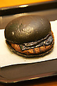 The &quot;Kuro Pearl&quot; burger at Burger King restaurant on September 19, 2014 in Tokyo Japan. Burger King launches to its menu two kinds of black burgers &quot;Kuro Diamond&quot; and &quot;Kuro Pearl&quot; which contains black buns and black cheese made from bamboo charcoal, garlic sauce made with squid ink and beef patties made with black pepper all in black color starting on Friday, September 19 for a limit period. The Kuro Diamond priced at 690 JPY <br /> (6.35 USD) and the Kuro Pearl which cost at 480 JPY (4.42 USD). The last year Burger King included the &quot;Ninja Burger&quot; similar black burger on its Japanese menu. (Photo by Rodrigo Reyes Marin/AFLO)