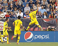 Columbus Crew forward Federico Higuain (10) celebrates his goal with teammates. Foxborough, Massachusetts - July 26, 2014:  In a Major League Soccer (MLS) match, Columbus Crew (yellow) defeated the New England Revolution (blue/white), 2-1, at Gillette Stadium.