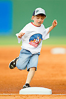 A young fan makes sure he touches third base during the mascot race between innings of the International League game between the Gwinnett Braves and the Charlotte Knights at Knights Stadium on June 3, 2012 in Fort Mill, South Carolina.  The Braves defeated the Knights 5-1.  (Brian Westerholt/Four Seam Images)