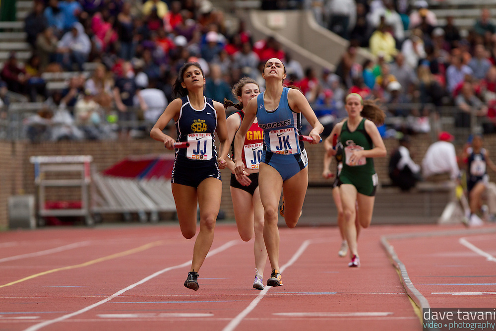 Gina Vanore of St. Basil, Emily Cable of Villa Maria, and Emma Keenan of GMA sprint down the homestretch in the High School Girls' 4x400 Philadelphia Academic. Vanore passed Cable just out of the final turn to win it for St. Basil in 4:00.21. Villa Maria took second in 4:00.39, while GMA took third in 4:00.71.
