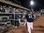 Reno Aces' Jake Barrett and Charles Brewer wave to the crowd as they celebrate the Pacific Conference Championship after defeating the Las Vegas 51s, 7-3, in Reno, Nev., on Saturday, Sept. 6, 2014.<br /> Photo by Cathleen Allison