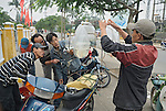 Asia, Vietnam, Hoi An. Hoi An nr.  old quarter. Street vendor selling toy fish from the back of his motorbike. The historic buildings, attractive tube houses, and decorated community halls have 1999 earned Hoi An's old quarter the status of a UNESCO World Heritage Site. To protect the old quarter's character stringent conversation laws prohibit alterations to buildings, as well as the presence of cars on the roads.