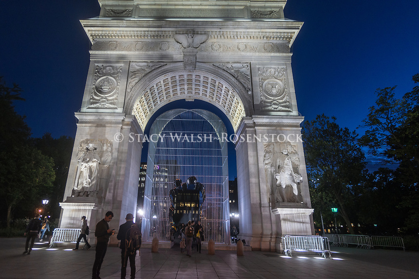"""New York, USA. 12 Oct, 2017 Ai Weiwei's sculptural installation """"Good Fences Make Good Neighbors"""" officially opens to the public. The installation of 300 sculptures throughout the City is slated to run through February, in conjunction with the Public Art Fund's 40 anniversary. People in Washington Square took pictures and walked through the sculpture's passageway. According to Chinese dissident and human rights activist Ai Weiwei, the work is Inspired by the international migration crisis and current global geopolitical landscape Credit: Stacy Walsh Rosenstock/Alsmy Live News"""