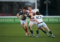 George Horne of London Scottish Football Club tries to break away from Tristan Roberts of Ealing Trailfinders during the Greene King IPA Championship match between London Scottish Football Club and Ealing Trailfinders at Richmond Athletic Ground, Richmond, United Kingdom on 26 December 2015. Photo by Alan  Stanford / PRiME Media Images