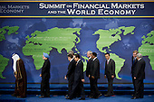 Washington, DC - November 15, 2008 -- World leaders walk off stage after a group photo at the start of the Summit on Financial Markets and the World Economy at the National Building Museum in Washington, D.C., USA, 15 November 2008. The leaders of 20 countries are in attendance. .Credit: Matthew Cavanaugh - Pool via CNP
