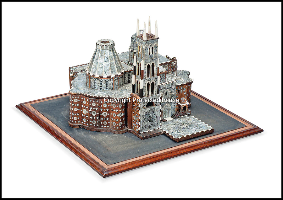 BNPS.co.uk (01202 558833)<br /> Pic: Christie's/BNPS<br /> <br /> ***Please use full byline***<br /> <br /> A mother-of-pearl, ivory and bone inlaid olivewood architectural model of the holy sepulchre.<br /> <br /> An interior designer to the stars is selling virtually the entire contents of her multi-million pounds London apartment that she is moving out of.<br /> <br /> Tessa Kennedy's client list for home makeovers has included Elizabeth Taylor, George Harrison and Pierce Brosnan as well as famous hotels like the Ritz and Claridges.<br /> <br /> During her jet-set career, she acquired opulent pieces of furniture, art work and ornaments from around the world that she filled her town and country residence with.<br /> <br /> Now aged 75, Miss Kennedy no longer requires her three-bed Knightsbridge flat and is auctioning off most of its contents in a unique sale at Christie's.