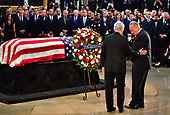 United States Senators Chuck Schumer and Mitch Mcconnell stand over the casket of former Senator John McCain in the Capitol Rotunda where he will lie in state at the U.S. Capitol, in Washington, DC on Friday, August 31, 2018. McCain, an Arizona Republican, presidential candidate and war hero died August 25th at the age of 81. He is the 31st person to lie in state at the Capitol in 166 years.    Photo by Kevin Dietsch/UPI