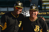 Bradenton Marauders Edwin Espinal (14) and Jin-De Jhang (47) in the dugout before a game against the Charlotte Stone Crabs on April 22, 2015 at McKechnie Field in Bradenton, Florida.  Bradenton defeated Charlotte 7-6.  (Mike Janes/Four Seam Images)