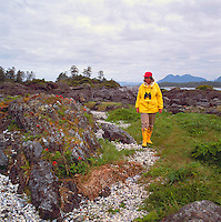 Hiker hiking on a Path of Broken Seashells, near Pacific Rim National Park Reserve, on West Coast of Vancouver Island, BC, British Columbia, Canada (Model Released)