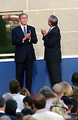 Washington, DC - September 11, 2002  - U.S. President George W. Bush waves to the participants of the  9/11 attack commerative ceremony at the Pentagon in Washington on 11 September 2002. Left to right: Mrs. Joyce Rumsfeld, Secretary of Defense Donald Rumsfeld,  First Lady Laura Bush, President Bush.<br /> Credit: Ron Sachs / CNP
