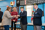 NAUGATUCK, CT. 08 December 2018-120818 - Chaplain Bill Detlefsen, center, presents Judi Taylor with a commemorative lapel pin as Sergeant of Arms Ron Fischer, right, and Naugatuck Deputy Mayor Laurie Tad-Jackson look on during the honoring of Vietnam Veterans Spouses, part of the the Certificate of Honor Program at the American Legion Post 17 in Naugatuck on Saturday. This is the first time in Connecticut that any type of honor has been given to the spouses. Bill Shettle Republican-American