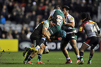 Freddie Burns of Leicester Tigers is tackled by Ben Botica of Harlequins. Aviva Premiership match, between Harlequins and Leicester Tigers on February 19, 2016 at the Twickenham Stoop in London, England. Photo by: Patrick Khachfe / JMP