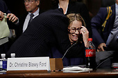 Professor Christine Blasey Ford, who has accused U.S. Supreme Court nominee Brett Kavanaugh of a sexual assault in 1982, is embraced by attorney Debra Katz at the conclusion of her testimony before a Senate Judiciary Committee confirmation hearing for Kavanaugh on Capitol Hill in Washington, U.S., September 27, 2018. REUTERS/Jim Bourg