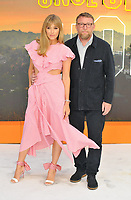 """LONDON, ENGLAND - JULY 30: Jacqui Ainsley and Guy Ritchie at the """"Once Upon A Time In ... Hollywood"""" UK film premiere, Odeon Luxe Leicester Square, Leicester Square, on Tuesday 30 July 2019 in London, England, UK.<br /> CAP/CAN<br /> ©CAN/Capital Pictures"""