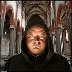 Don Dario, nato in Italia, oblato benedettino.<br /> Dalla serie di ritratti ispirati a I Versi Satanici di Salman Rushdie, in rappresentanza delle principali culture spirituali del pianeta.