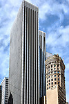 Vintage Hobart Building in contrast to the adjacent modern tower as viewed from Market Street in San Francisco.