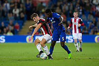 Ched Evans of Cardiff City challenges Bruno Manga of Cardiff City during the Sky Bet Championship match between Cardiff City and Sheffield United at Cardiff City Stadium, Cardiff, Wales on 15 August 2017. Photo by Mark  Hawkins / PRiME Media Images.