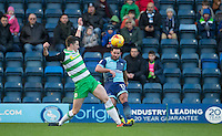 Sam Wood of Wycombe Wanderers hits the ball past Alex Lacey of Yeovil Town during the Sky Bet League 2 match between Wycombe Wanderers and Yeovil Town at Adams Park, High Wycombe, England on 14 January 2017. Photo by Andy Rowland / PRiME Media Images.
