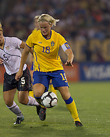Sweden midfielder Nilla Fischer (18) dribbles as US midfielder Lori Lindsey (5) defends. The US Women's national team beat Sweden, 3-0, at Rentschler Field on July 17, 2010.