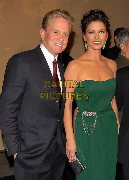 "MICHAEL DOUGLAS, CATHERINE ZETA JONES.attends The 2nd Annual ""A Fine Romance"" to benefit The Motion Picture & Television Fund held at Sony Picture Studios in Culver City, California, USA, .October 20th 2007..half length green strapless dress earrings red tie husband wife married couple silver clutch bag                              .CAP/DVS.©Debbie VanStory/Capital Pictures"