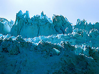 Art in Nature 9607-0170 - This glacier 'mountain', with its majestic peaks, is saturated with the natural blue colors of the surrounding environment. Northern Rocky Mountains, Alaska.