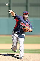 Doug Mathis of the Cleveland Indians pitches against the Oakland Athletics in a spring training game at Phoenix Municipal Stadium on March 2, 2011  in Phoenix, Arizona. .Photo by:  Bill Mitchell/Four Seam Images.